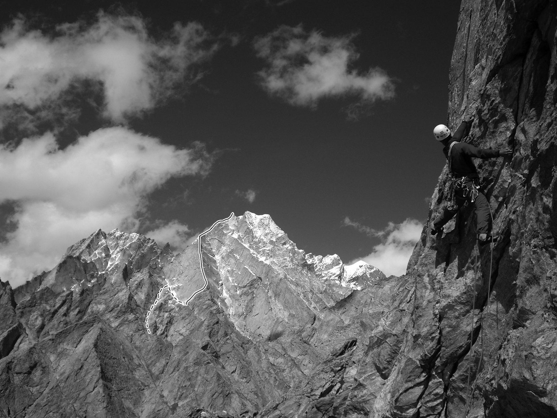 Andrej Gmorsek on Loofolam, with Korklum Gou–Window Peak (ca 5,600m) in the background, showing the 600m-vertical Shangrila Ridge route. Tanja Grmorvsek