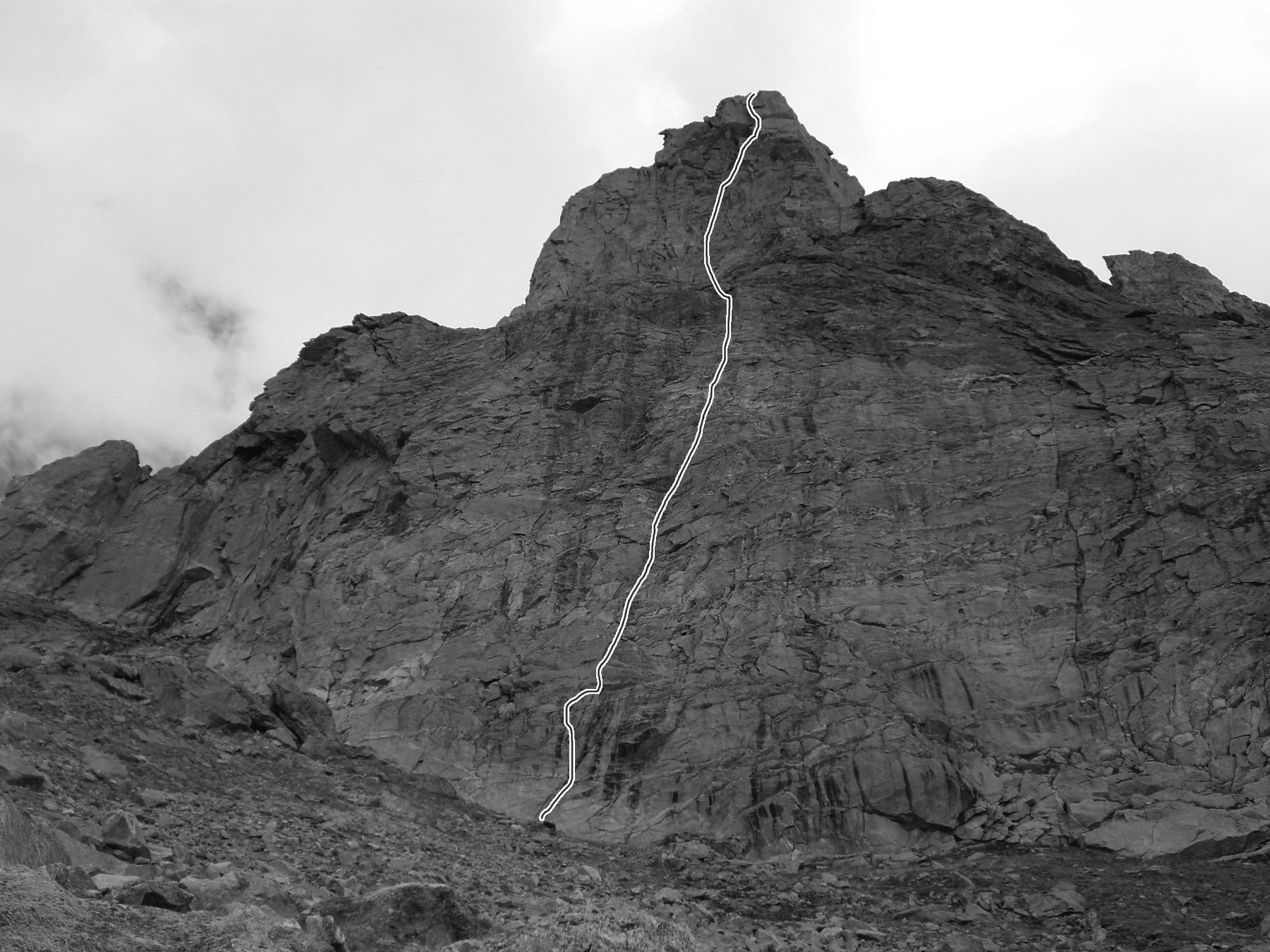 David's 62 Nose (ca 4,950m) on Castle Peak's south face, showing 350m-vertical Lufoo Lam–Windy Way. Andrej Grmovsek