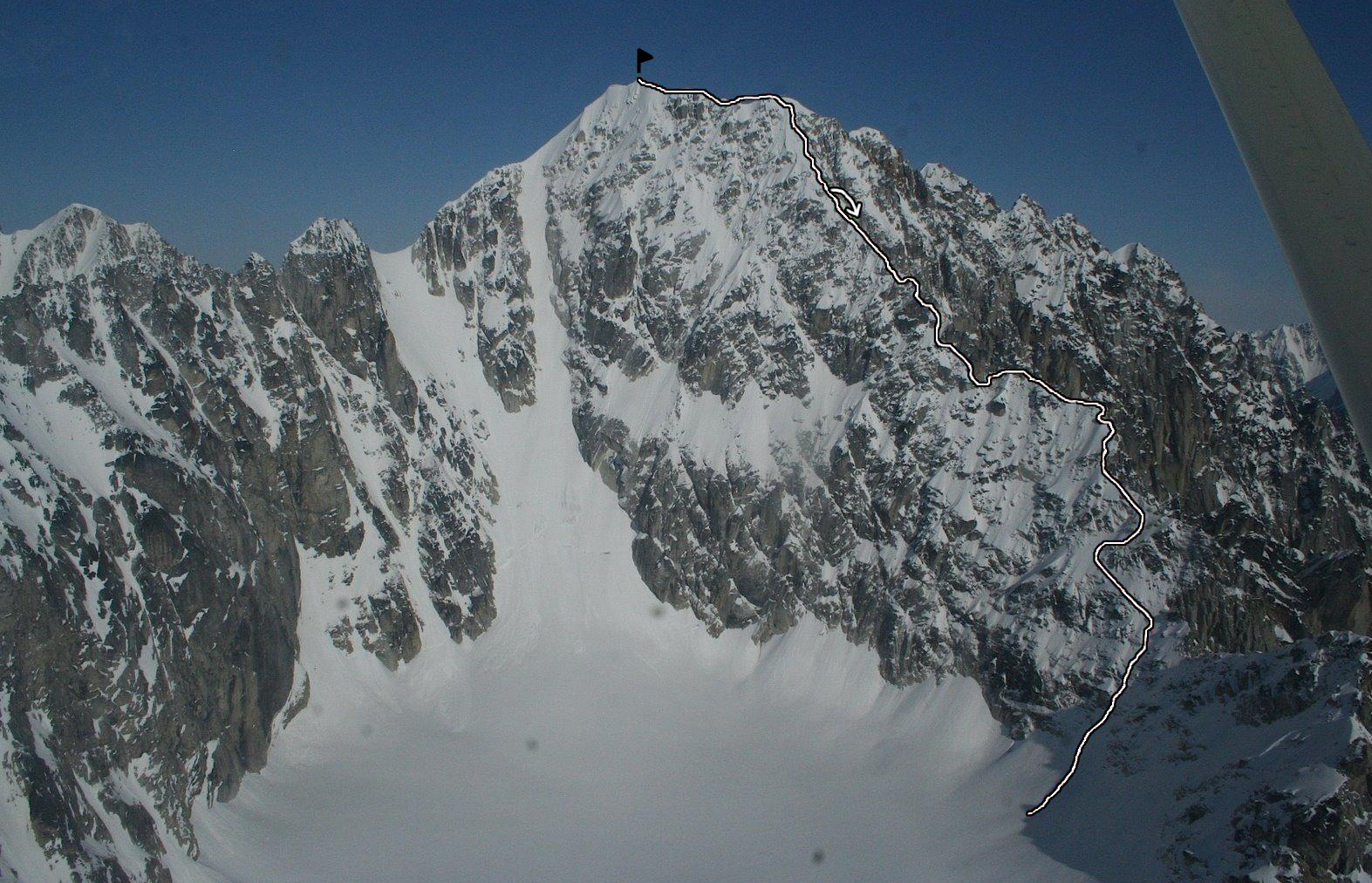 Ice Pyramid's first ascent route, with the arrow showing the rappel to the south on the descent.