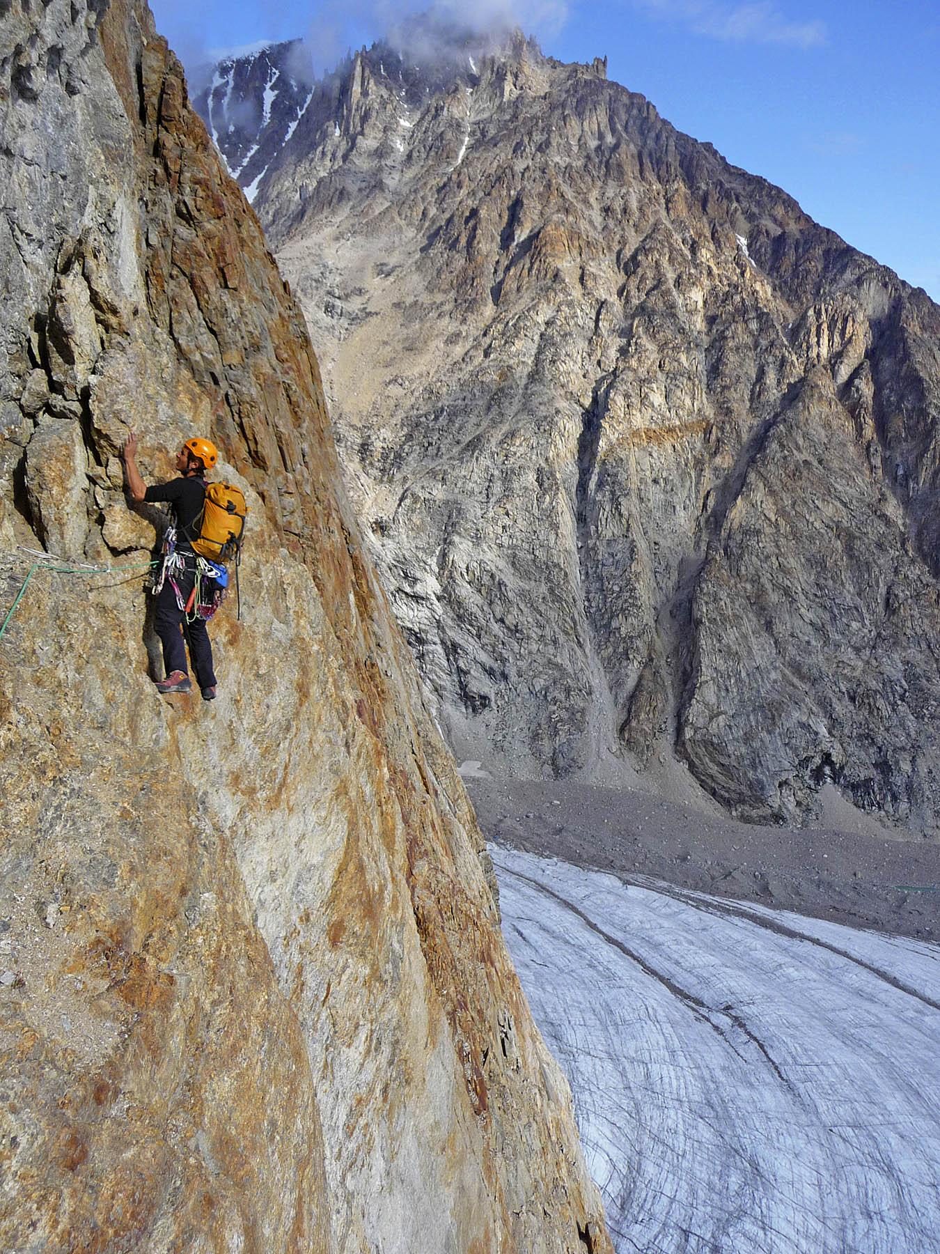 Niek de Jonge on the First Ascent Route, The Cenotaph. Below is the Apusinikajik Glacier.