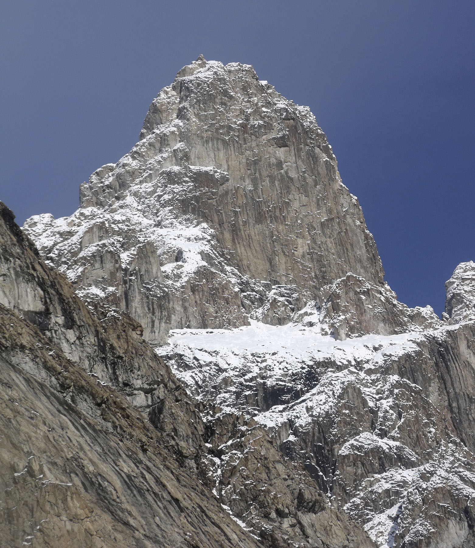 The unclimbed rock summit east of base camp attempted to 1,600m by Phillips, Porter, and Southgate.