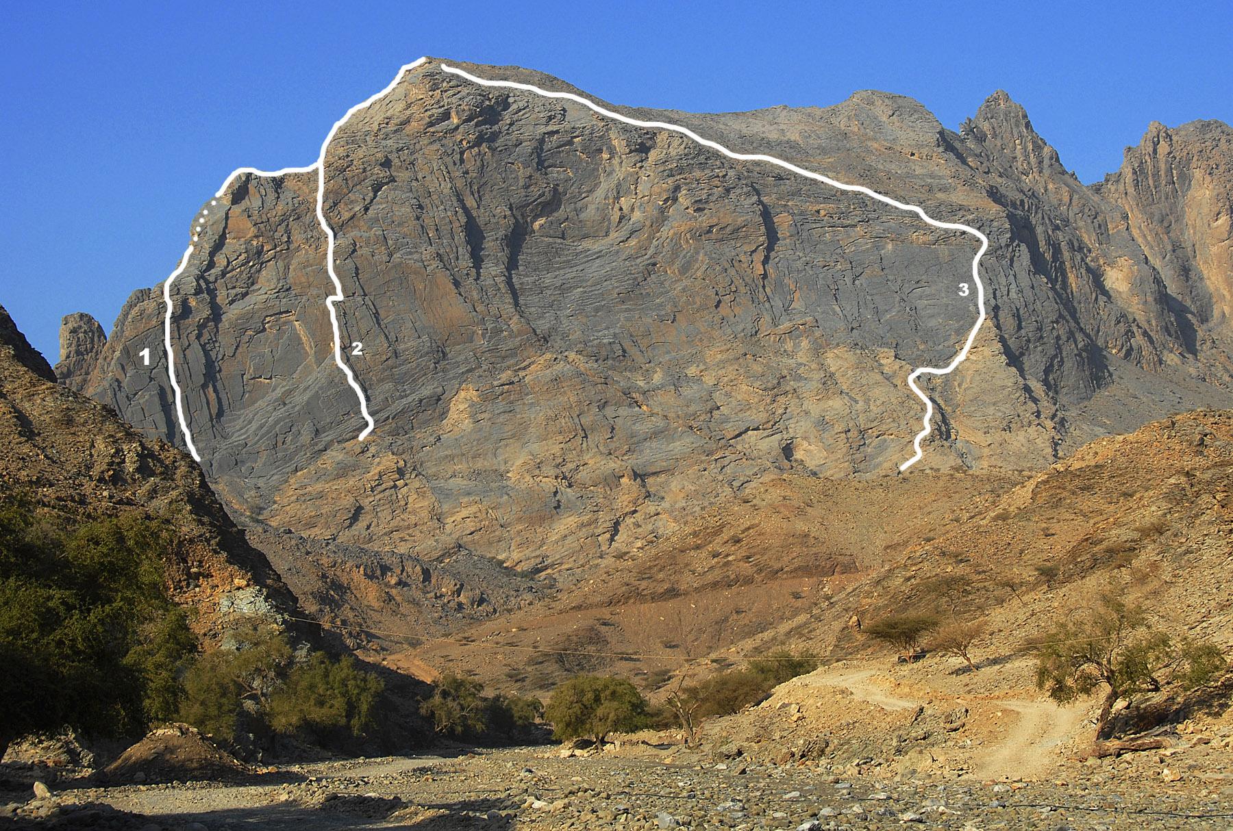The 500m east face of Jabal Nakhus. (1) F-Sharp (5.10, Gough-Sambataro, 2009). (2) Hand Grater. (3) Descent route.