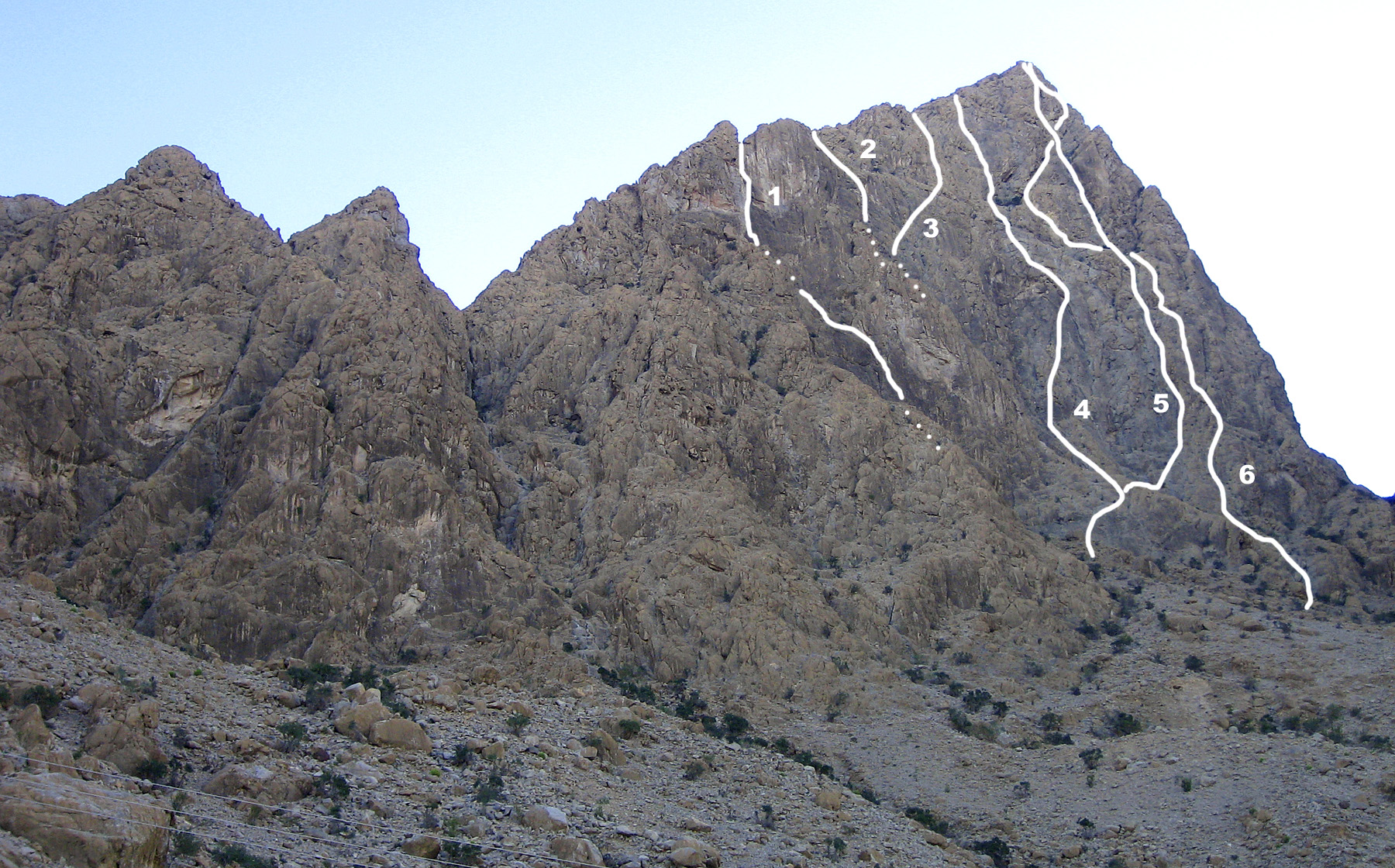 North face of Jabal Asala with approximate lines of a selection of routes: (1) Omanic (UIAA VI+, Brachmayer-Precht, 2002). (2) Route 1 (British VS 4b/c, Davison, solo, 2002), (3) Route 2 (British HS 4b, Davison, solo, 2002), (4) Ramadan for Bolts (UIAA VI+, Brachmayer-Eisendle, 2002), (5) Rock Fascination, and (6) Lulu.