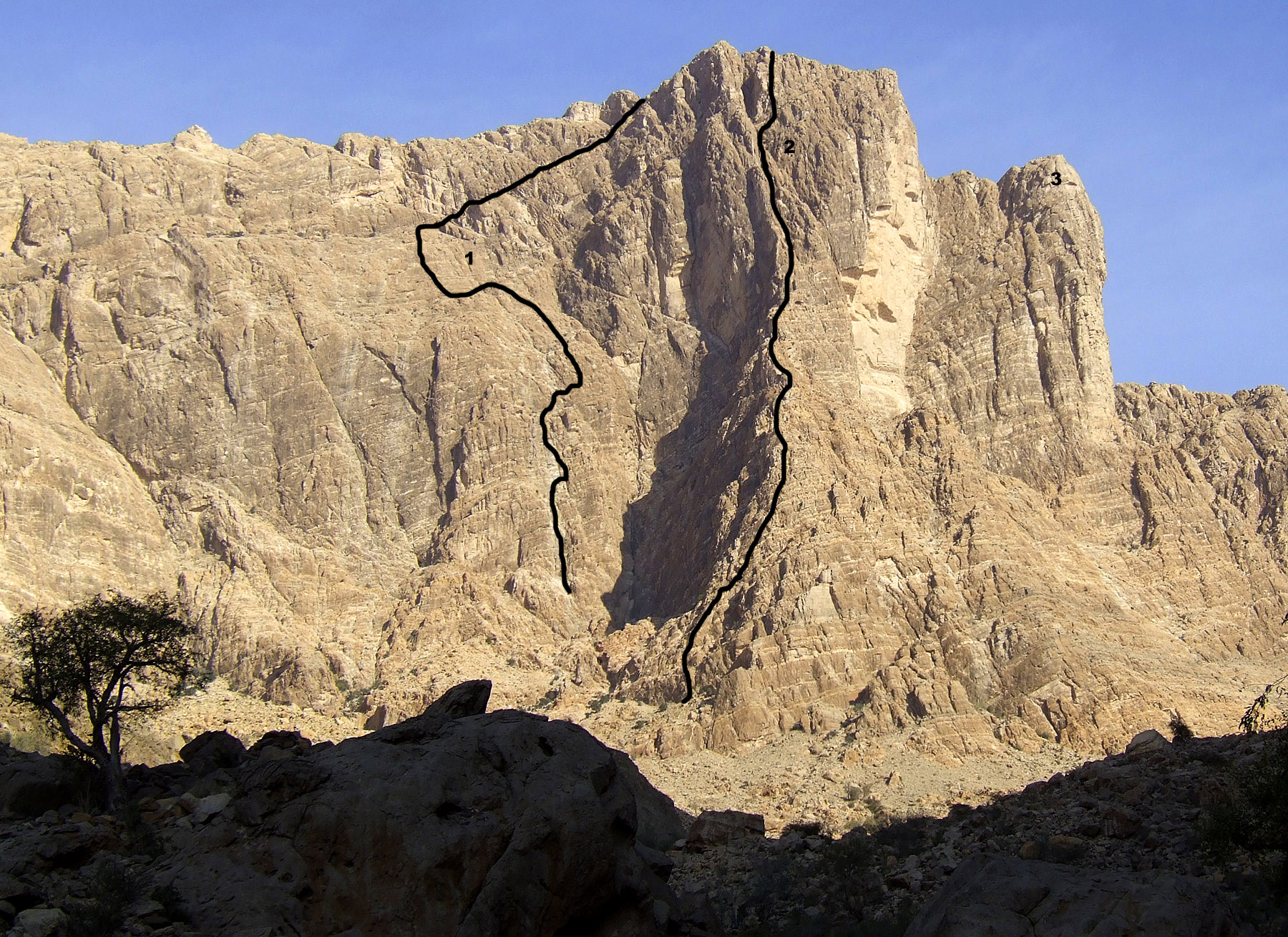 The right-hand end of the southwest face of Jabal Kawr, showing (1) M'Seed Rappers, and (2) Queen of Sheba (British E1 5a, Hornby-Ramsden, 1999). Wadi Girls (TD, Barlow-Nonis, 1999) takes front face of tower marked (3).