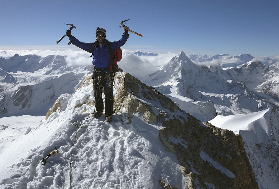 David Bingham on the summit of Sarasvati (6,184m). The elegant pyramid behind is Gangstang. David Bingham Collection