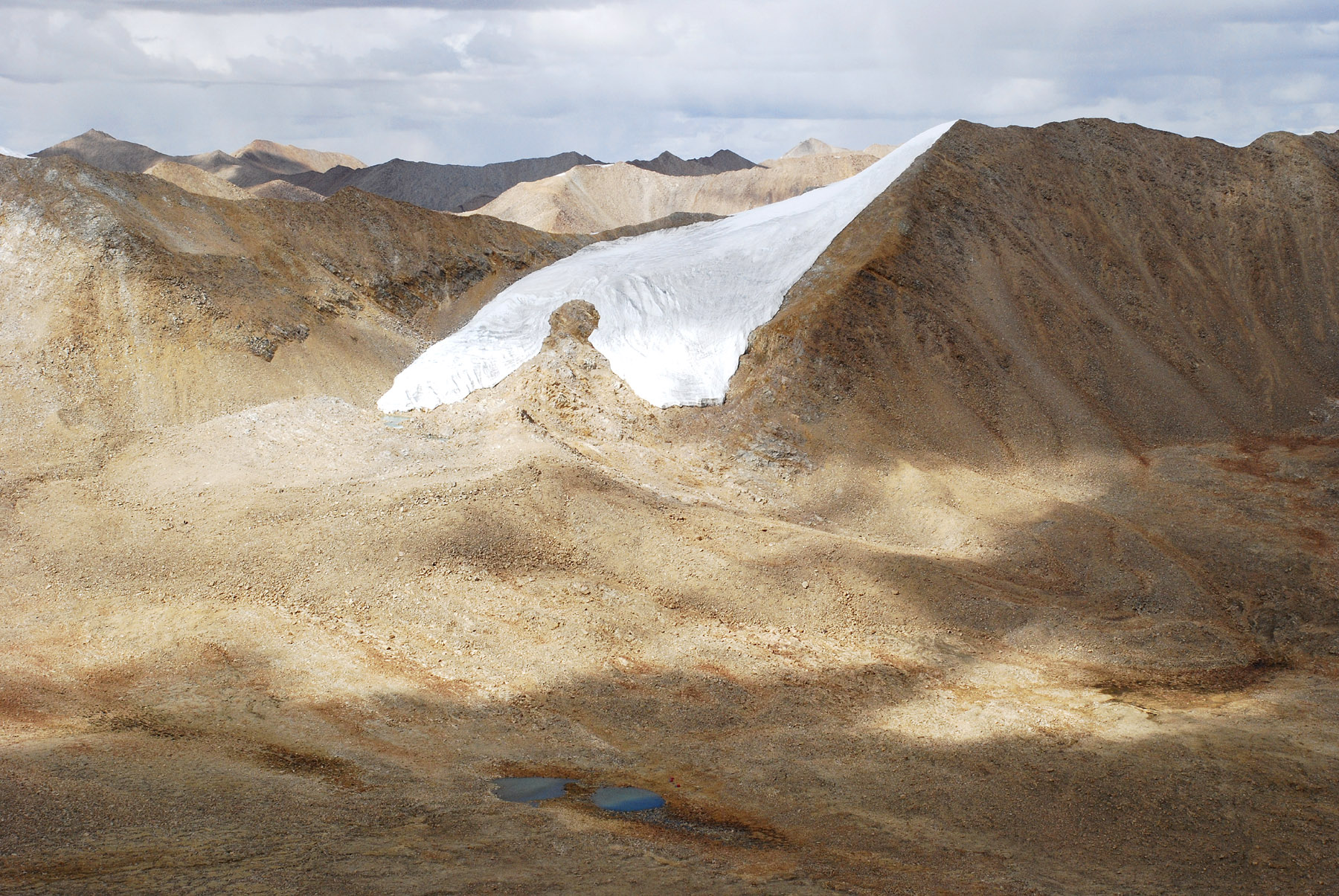 Typhoon Peak from Anige Chuli. High camp was by the two lakes; the mountain was ascended by the obvious snow tongue.