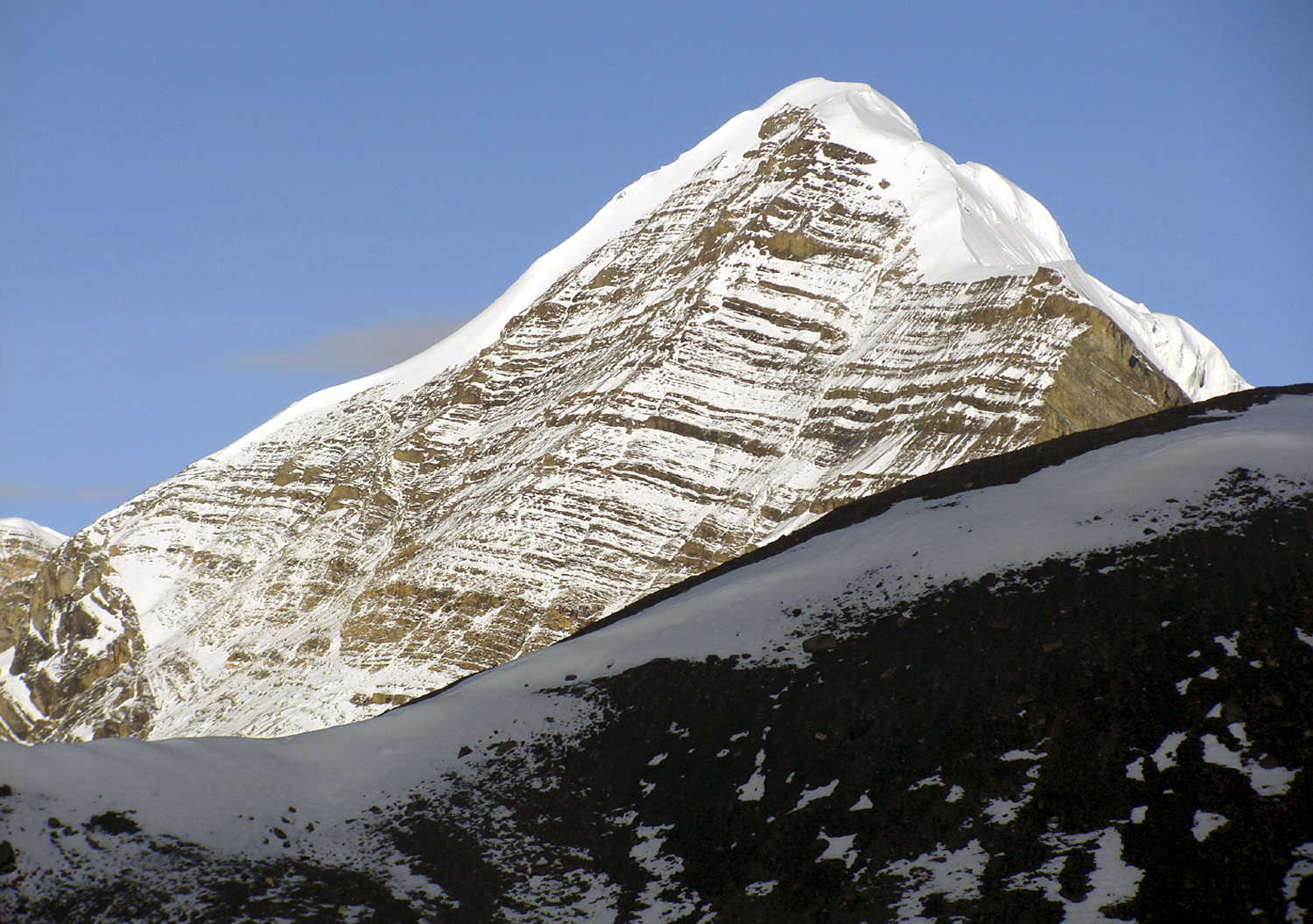 Unclimbed Peak 6,085m, immediately south of Amotsang, seen from north face of Pokharkan. In between lies unexplored valley of upper Loha Khola.
