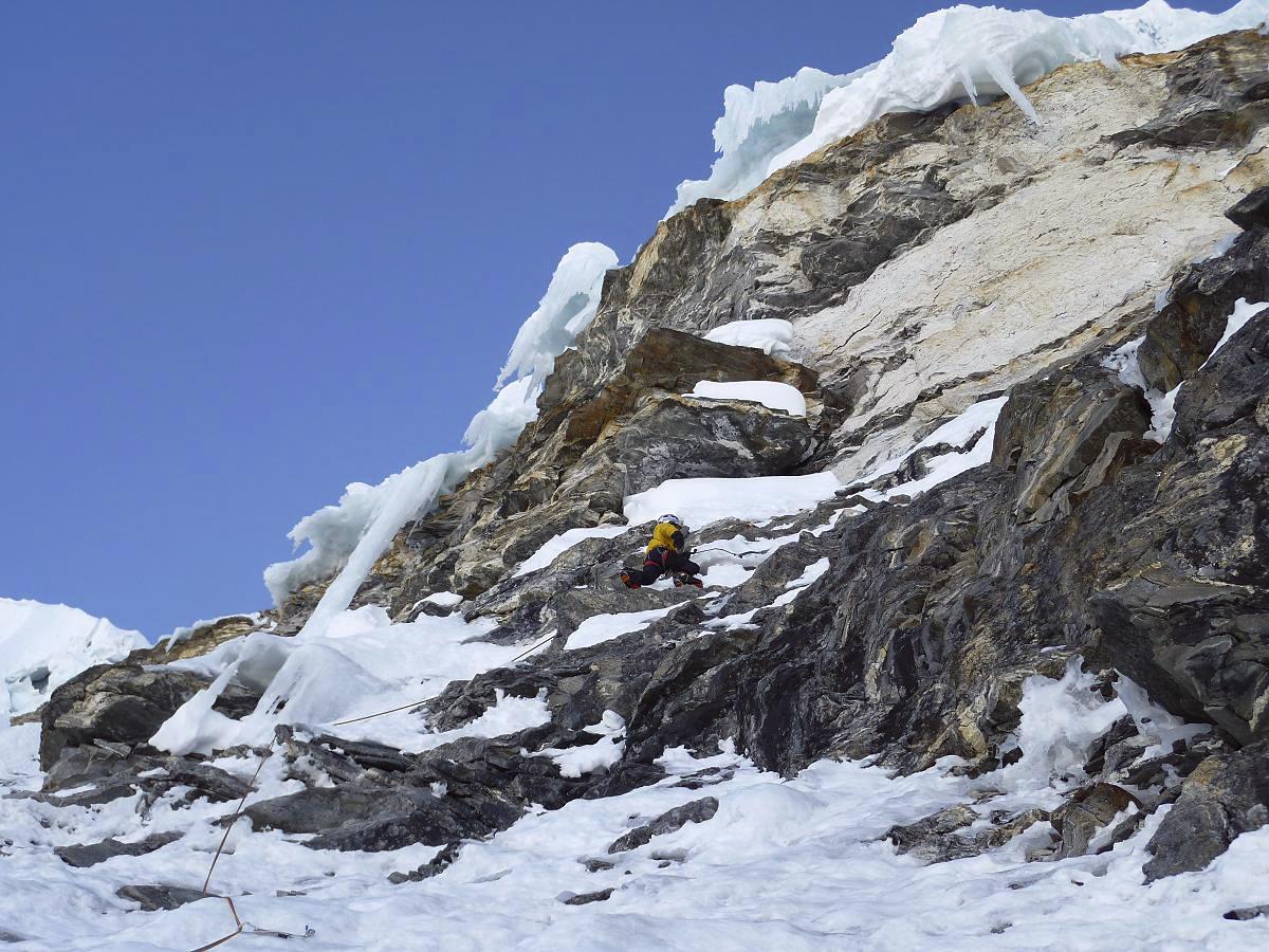 Attempting crux rock band close to summit ridge of Gaurishankar South.