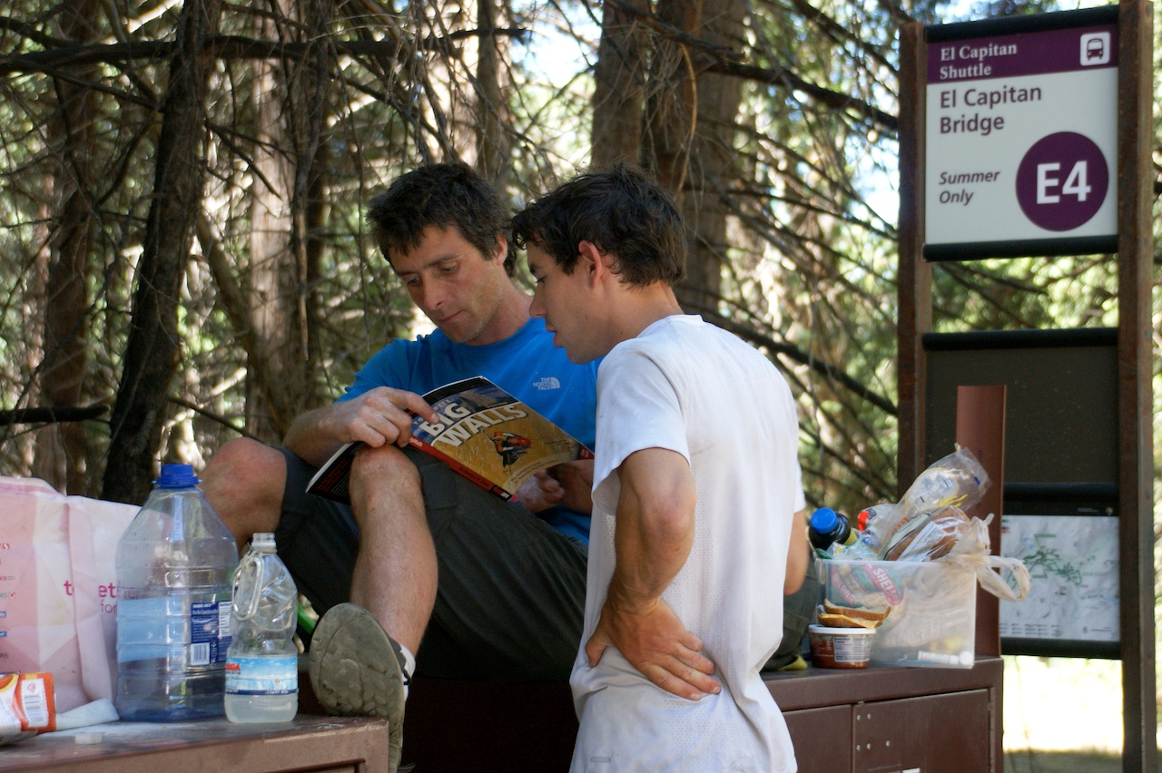 Sean Leary and Alex Honnold checking out the topo for Lurking Fear after getting down from the Nose and the Salathe.