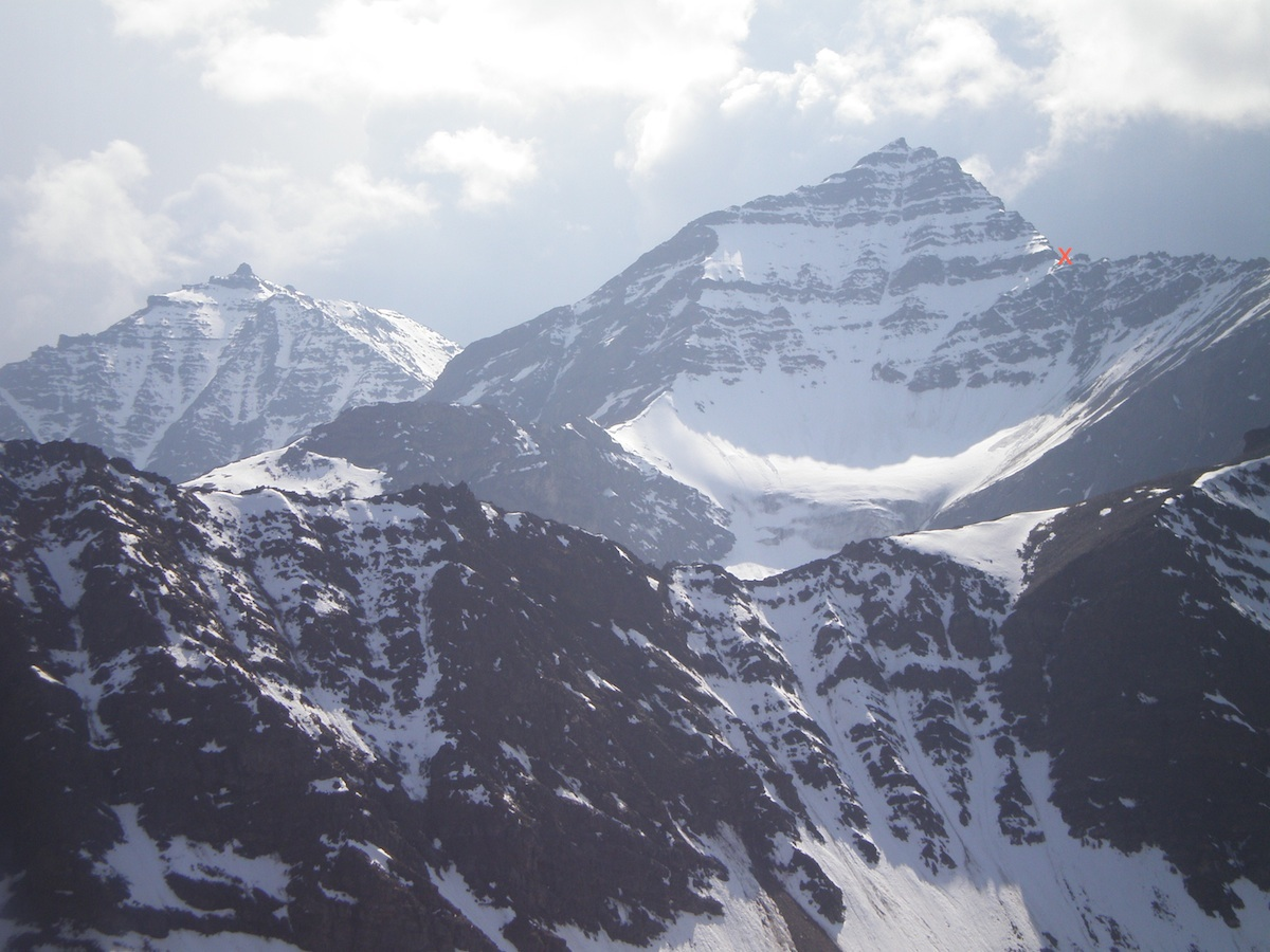 The likely unclimbed Peaks 2,220m North (right) and 2,220m South (left), with the team's high point marked. They started on the opposite side of the ridge to the right of the X, joining the ridge about midway along its visible length. The team suggests that these peaks would offer the most exciting climbs in the area