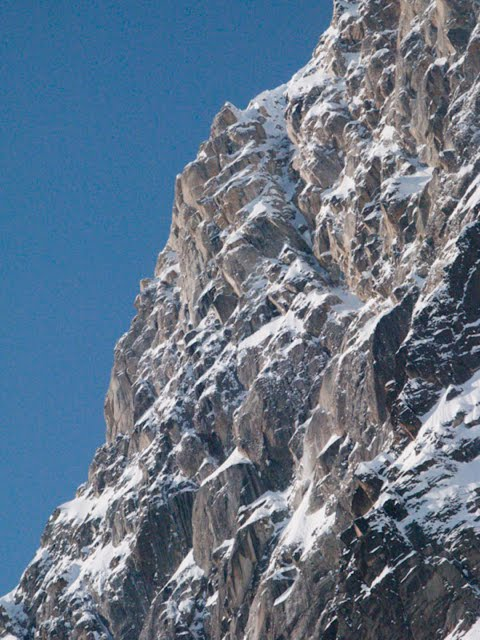The crux Tower section of Vitalogy. The original plan was to climb the couloir right of the tower, but the first storm brought too much spindrift, and so the pair climbed steeper terrain free from drainages. They followed the ridge crest to the base of the Tower, then climbed just left of skyline up a system of dihedrals.