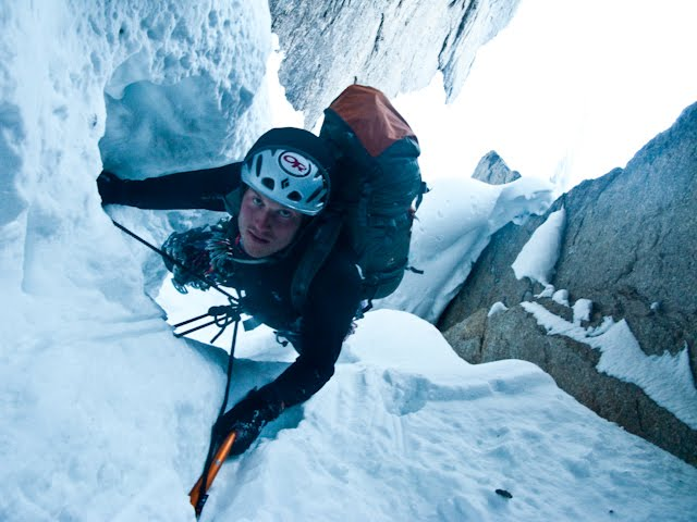 Graham Zimmerman climbs the mushroom tunnel at the end of the initial 700-foot pitch, which opened with a prominent lightning-bolt-shaped couloir.