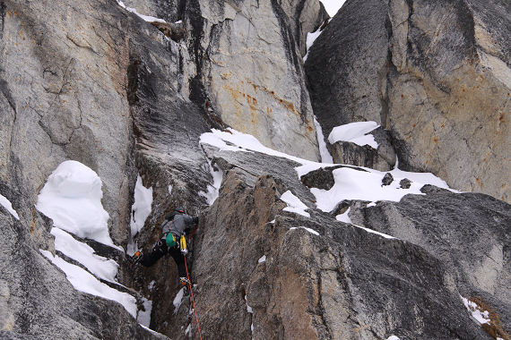 Climbing on the Optimist, the new route on the west face of Peak 7,400'.