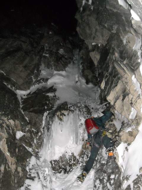 Kevin Ditzler starting the crux pitch of Darkness Falls.