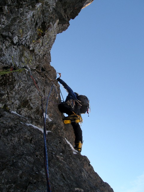 John Kelley leading into the rock buttress on The Cancer.
