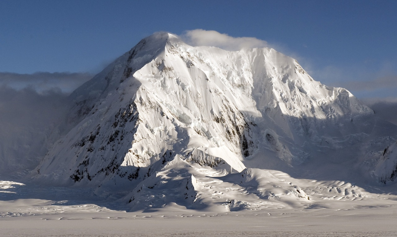 Mt. Augusta, with the Northeast Pillar climbing the obvious sun-shade line.