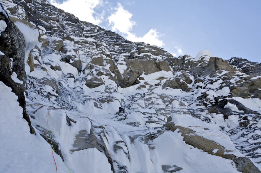 Jason Kruk leading new terrain on Mt. Robson's Emperor Face.