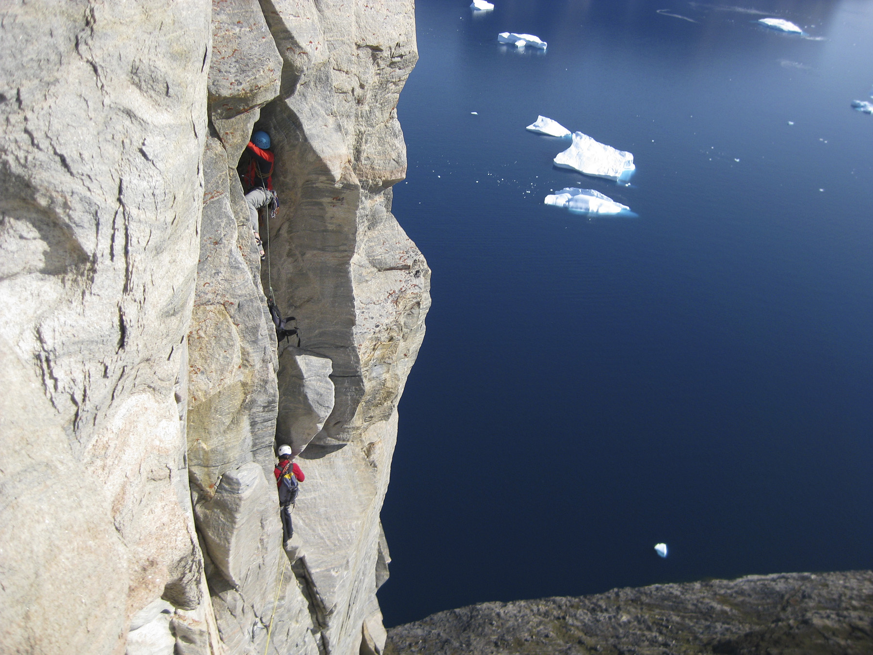 Silvan Leinss following pitch five (5.9) of the Doyle-Leinss Route (just lead by Sam Doyle) on Ummannaq.