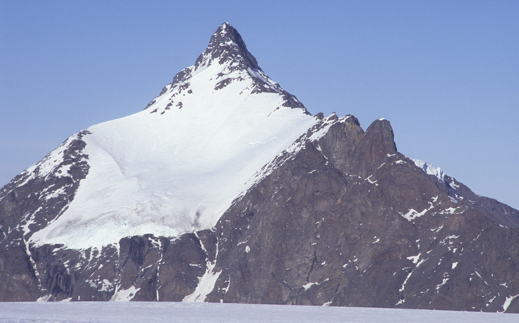 Arken (Ark) seen from a distance of eight kilometers to the northwest. The 2010 attempt ran across the south face, out of sight to the right.