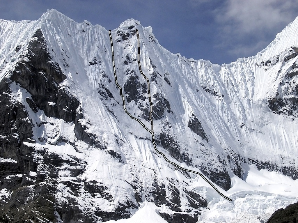 The Spanish climbing on the west face of Mituraju, with Está el Barrio Que da Miedo on the left (ending at the ridge).