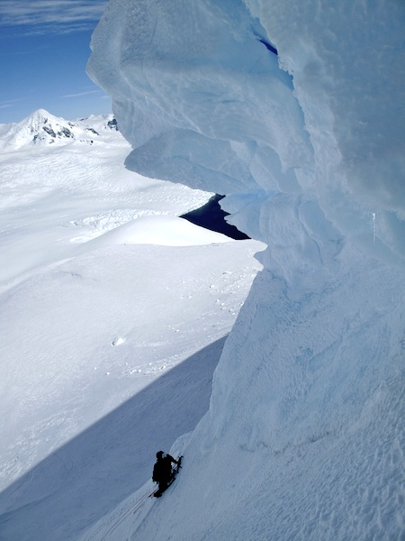 Fletcher and Metherell preparing to pass the serac on the steep, upper east face of Cloos.