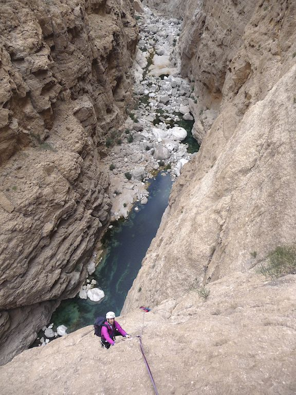 High above the waters of Wadi Tiwi during the first ascent of En Attendant Allah.