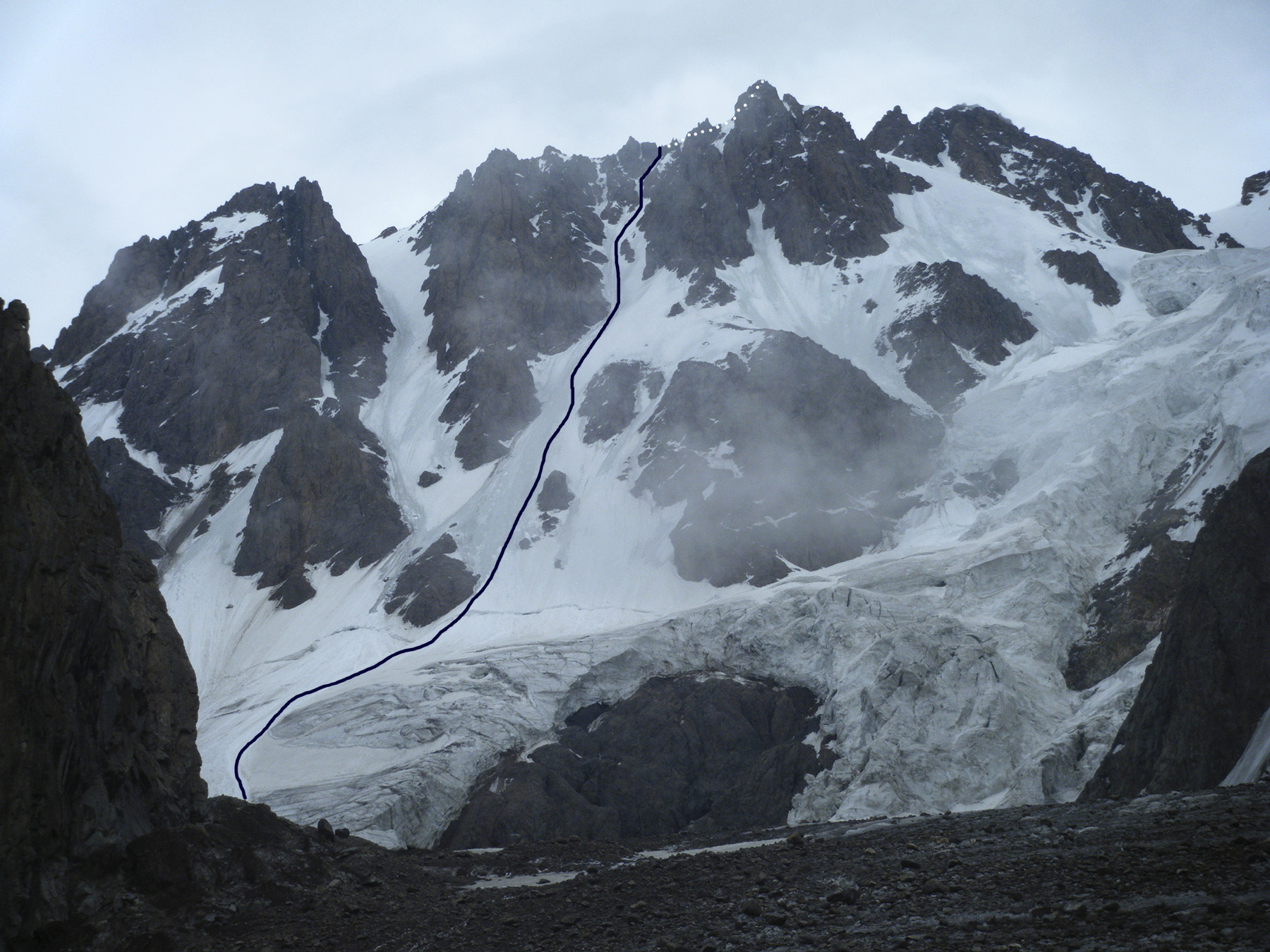 Northwest face of Talgar main summit showing 2010 Komarov-Urubko route right of the rock buttress of Pelevin's route.