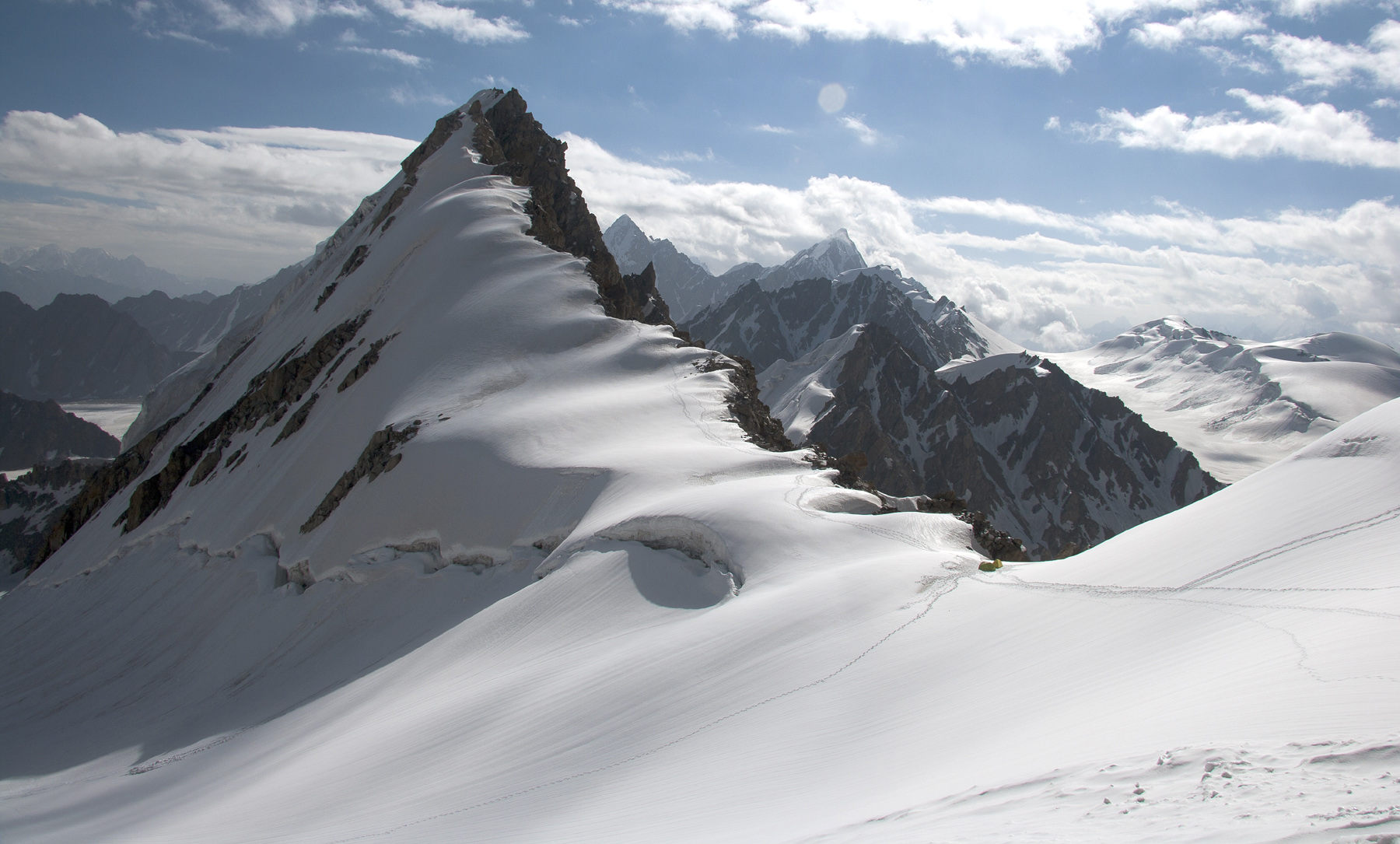 Koh-e-Forot Zorman. From col camp on the frontier ridge, the west ridge was followed to the summit. Photograph taken from low on east face of unnamed peak, attempted by Dutch.