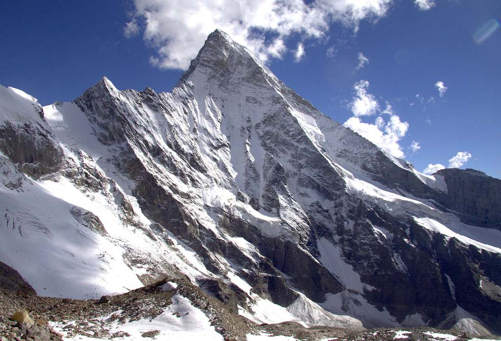 Shiva. The central spur attempted by Russians separates the east-northeast face on the left from the shorter north face seen almost in profile to the right. Andrey Muryshev