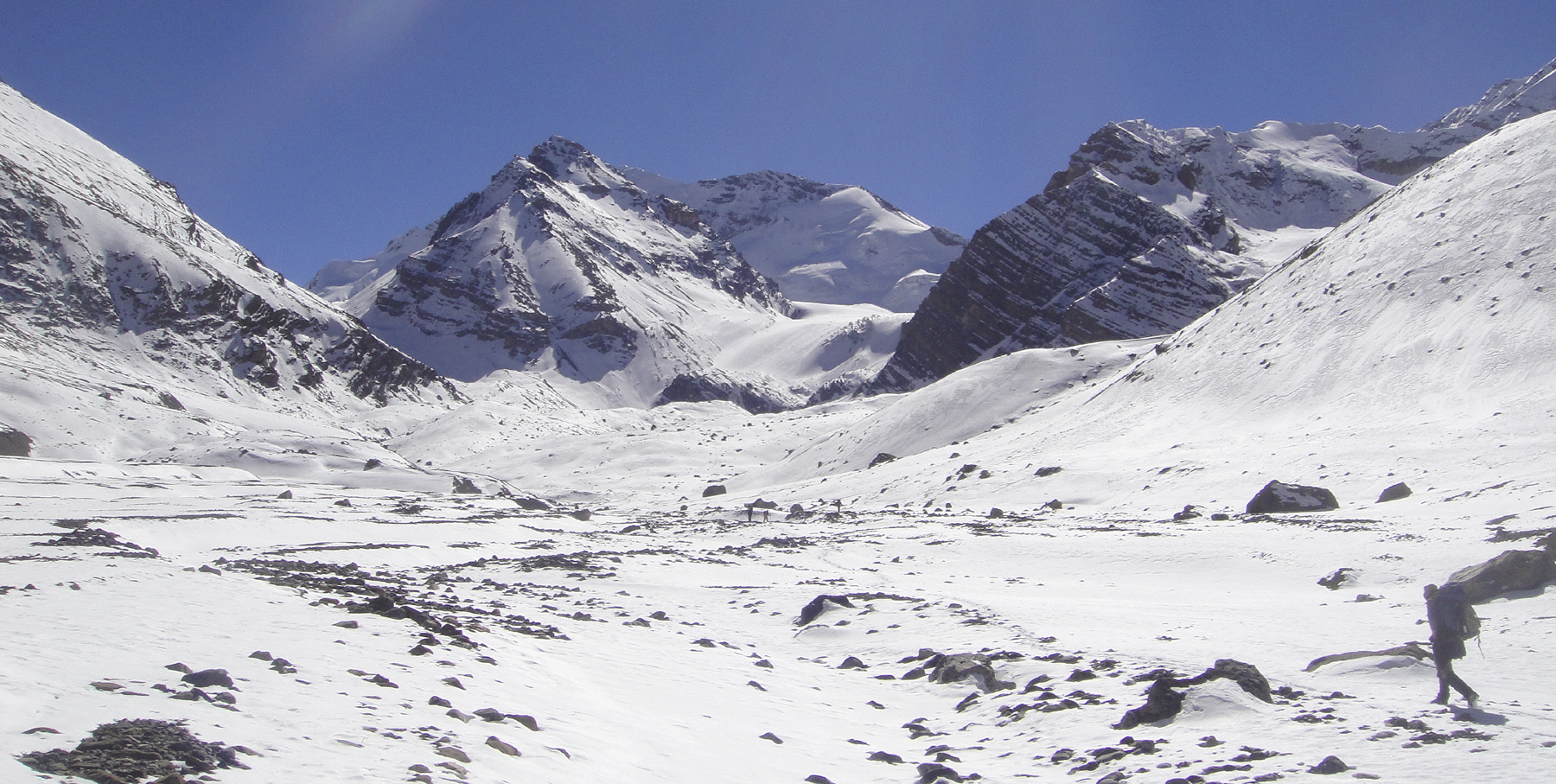 The head of the Singekang Valley. The snow and rock pyramid center is the northwestern outlier (dubbed Singekang Minor) of Singekang. Summit of Singekang is just visible immediately behind. Jeremy Windsor