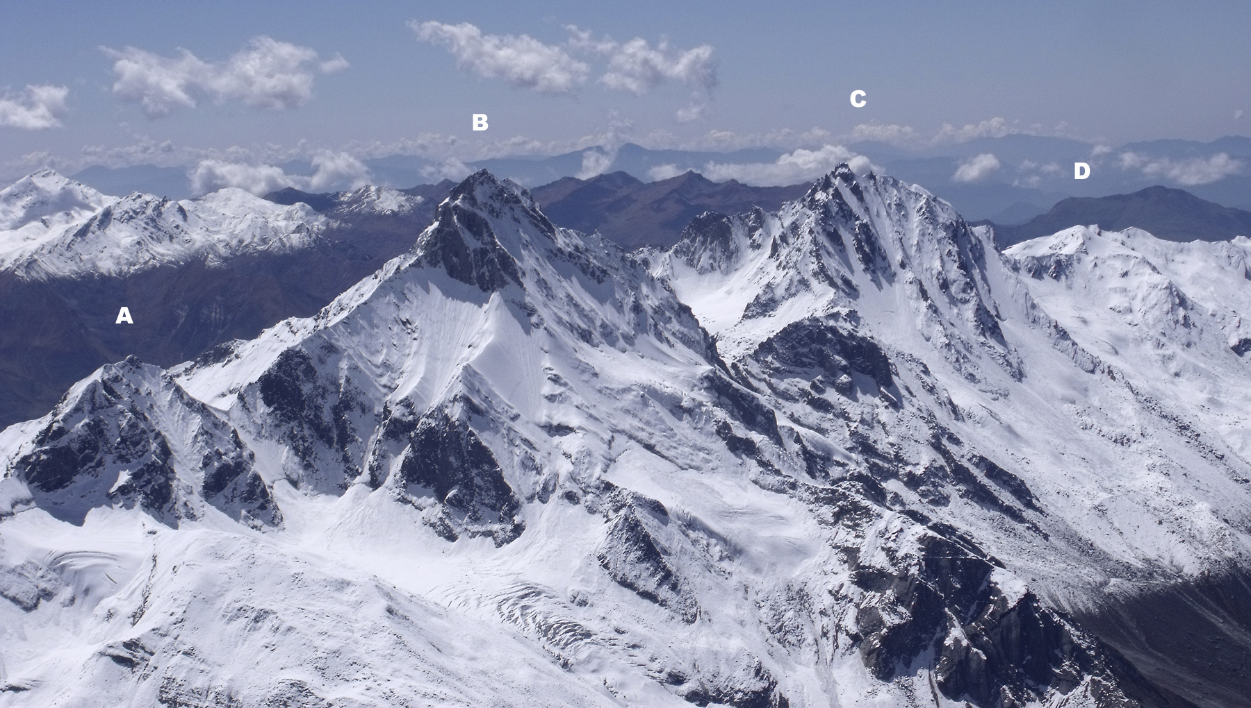 Looking southwest across the upper Obra Valley. (A) Andurko, (B) Ranglana , (C) Dhodhu (5,418m), and (D) Dhodhu Kha Guncha (5,135m). The ascent of Ranglana crossed the saddle between it and Dhodhu, then climbed the (hidden) south ridge. Jonathan Phillips