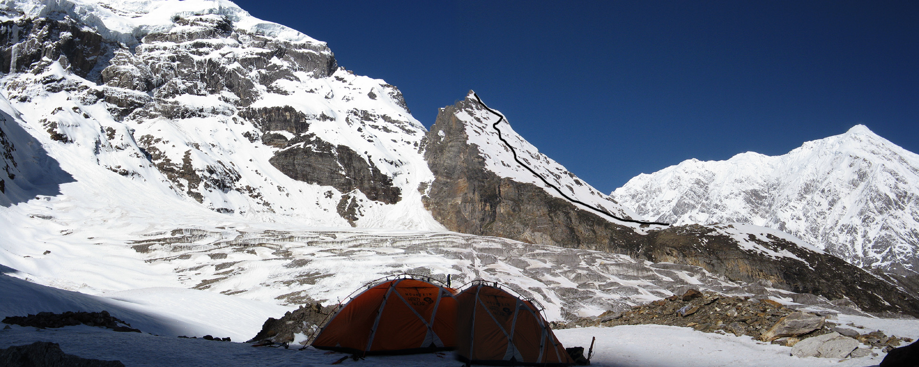 Kartik, with route of first ascent marked, lies to the right of the serac torn north face of Peak 5,812m. In the right distance is Chaukamba (7,138m). Daniela Teixeira