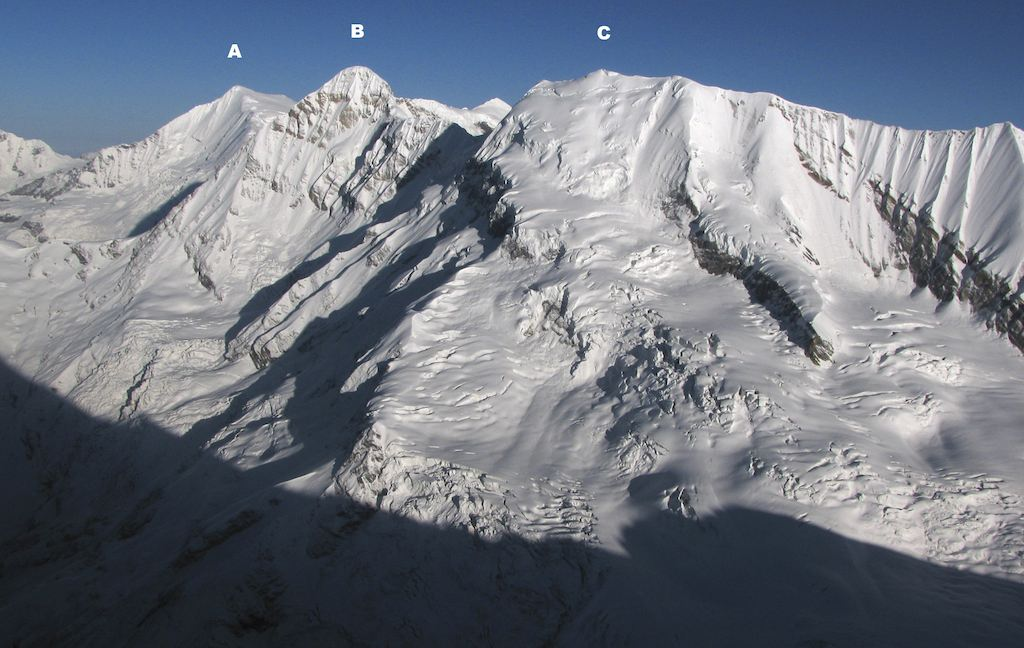 Looking southwest from northwest ridge of Changuch. In foreground are crevassed slopes of Traill's Pass, while Pindari Glacier lies down to left. (A) Maiktoli (6,803m), (B) Panwali Dwar (6,663m), and (C) Nanda Khat, with north-northeast ridge forming right skyline. Martin Moran