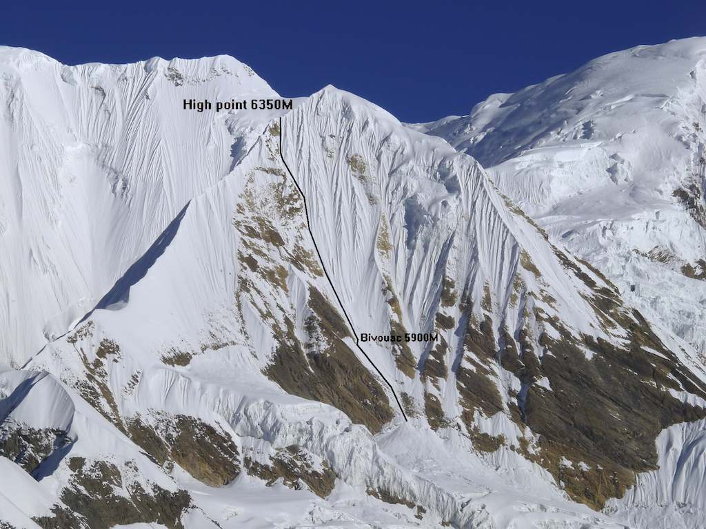 The south-southeast face of Singu Chuli seen from Tharpu Chuli. The Dutch line, bivouac, and high point on south ridge are marked. The original 1957 route took the right-hand ridge. Behind and to the right are the slopes of Tarke Kang (a.k.a. Glacier Dome, 7,193m), while above an to the left is the summit of Kangsar Kang (a.k.a. Roc Noir, 7,485m) at the start of the long east ridge of Annapurna, and on the left the south face climbed by French in 2000.