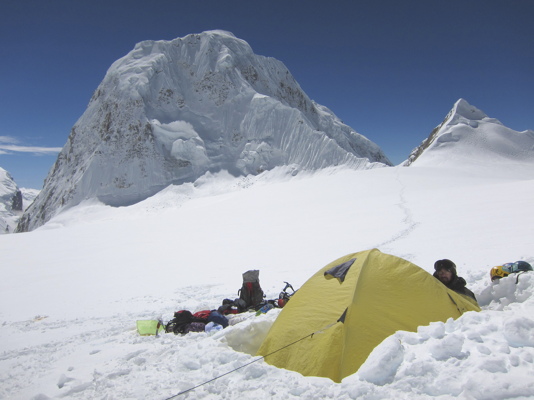 Looking south from Belarus-Russian top camp across the Thulagi plateau to Thulagi. The proposed route of ascent was the narrow, corniced, northwest ridge - a difficult objective.
