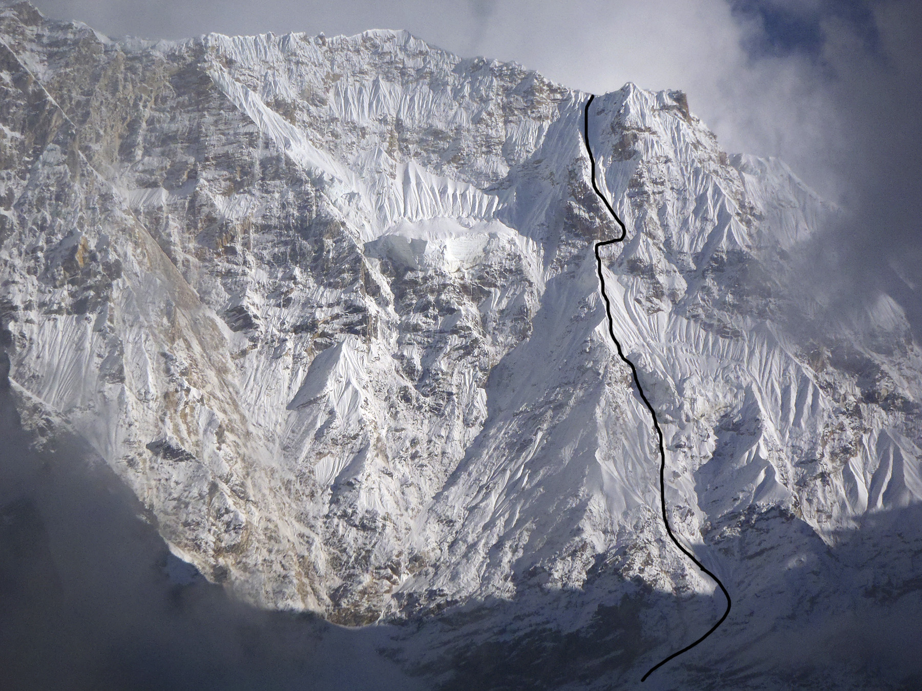 Belarus-Russian route up the northwest face of Manaslu shoulder to the ca 6,400m ridge. On the far side lies a large plateau - the upper Thulagi Glacier - rimmed with high peaks.