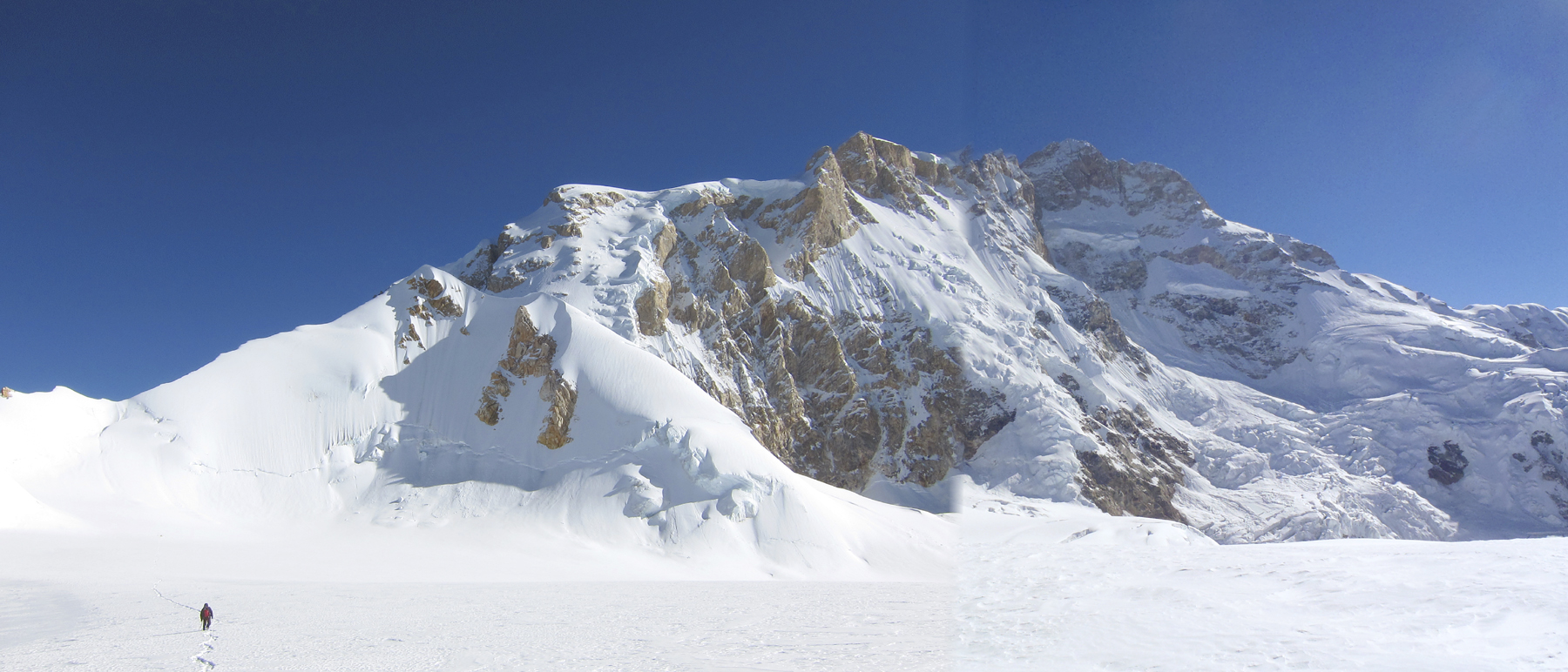 West ridge and southwest face of Manaslu (8,163m) seen from the Thulagi Plateau. This face was climbed by a large Austrian expedition in 1972, the summit reached by a certain Reinhold Messner, climbing alone.
