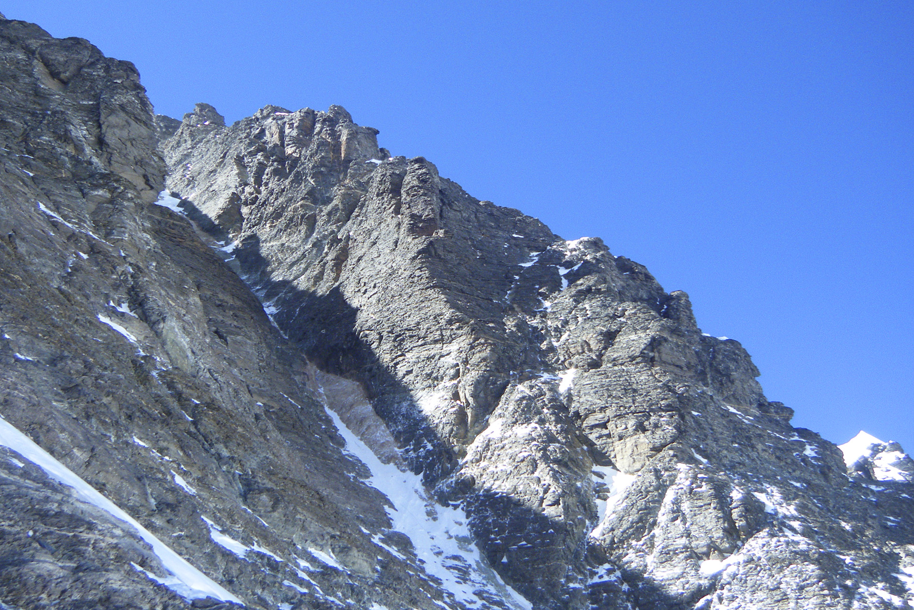 The last, delicate, slabby terrain leading into the west face couloir.