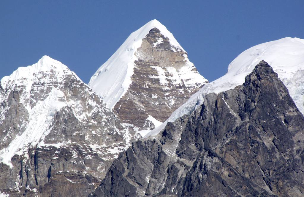 Pabuk Kang seen from the Marson La, a distance of almost 20km to the south. The first ascent followed the snow ridge immediately left of the rocky face.