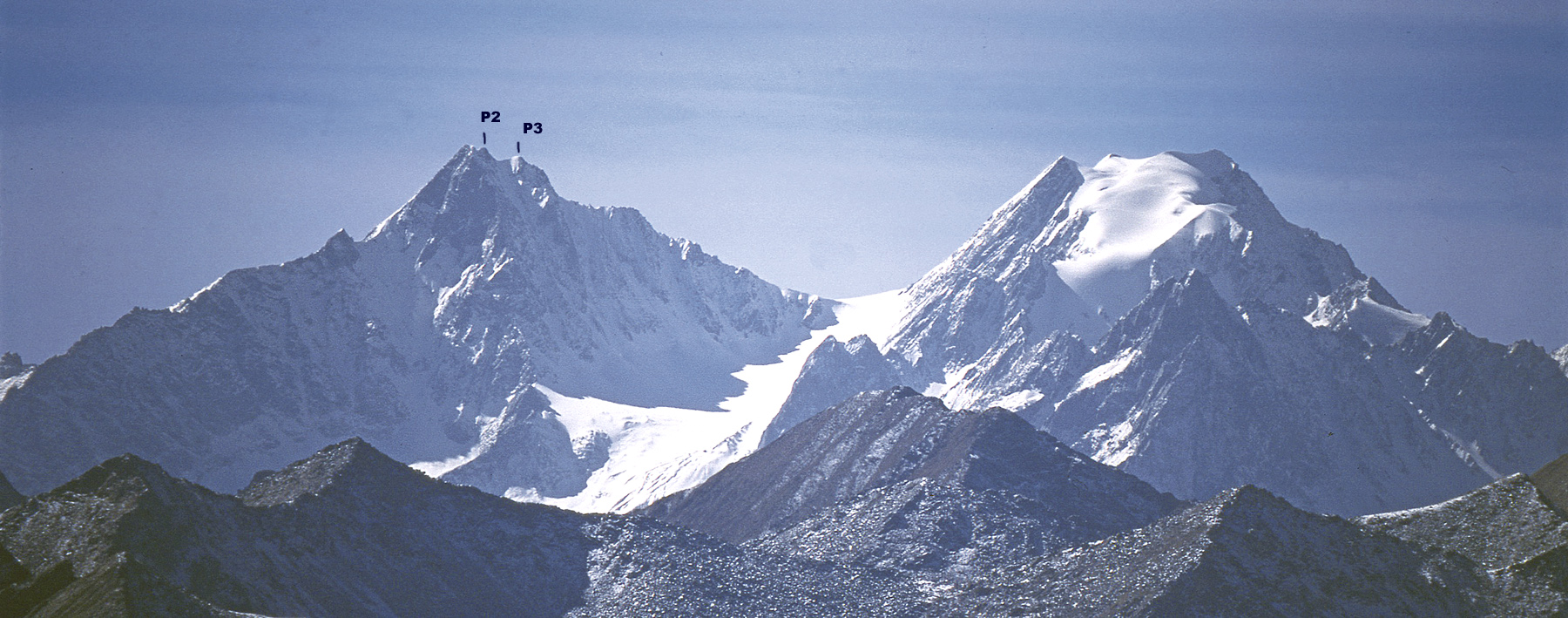 Xiaqiangla from the northeast. The summit to the right appears to be unspecified on maps, though another off picture to the right is marked as 5,240m. The north ridge attempt climbed from the broad snowy col between the two mountains. Peaks 2 and 3 on the north ridge are marked.