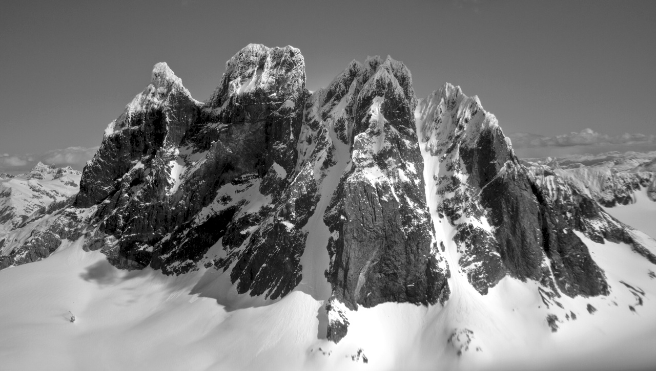 Devil's Paw from west. In 2011 tapering central couloir was climbed to notch right of main summit, then skied. Prominent right-hand couloir, climbed in 1976 en route to first ascent of south summit, was also skied.