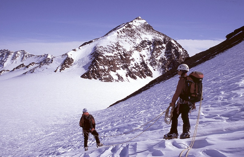 Sandy Gregson and Geoff Bonney (below) on north flank of Breidablikk, with Peak Gymir behind.