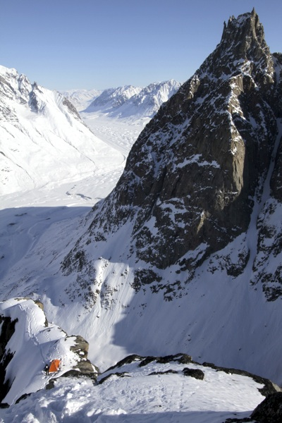 Mikhailov starts from final bivouac on northwest ridge of Shark's Tooth. Below is Edward Bailey Glacier.