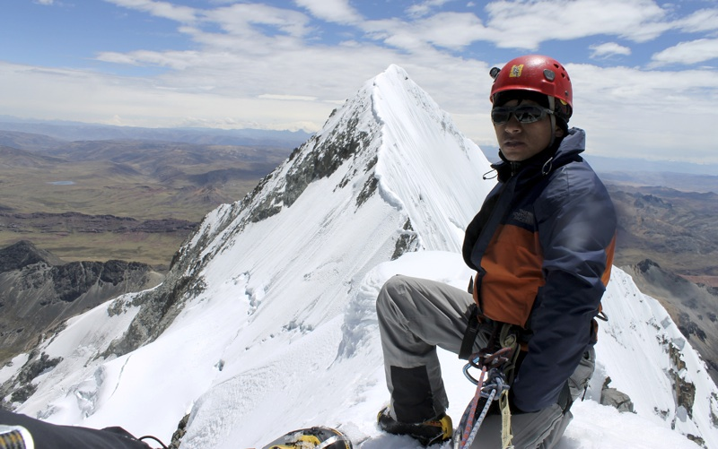 Morales on summit of Tunshu South. Ridge behind leads toward higher Tunshu North.