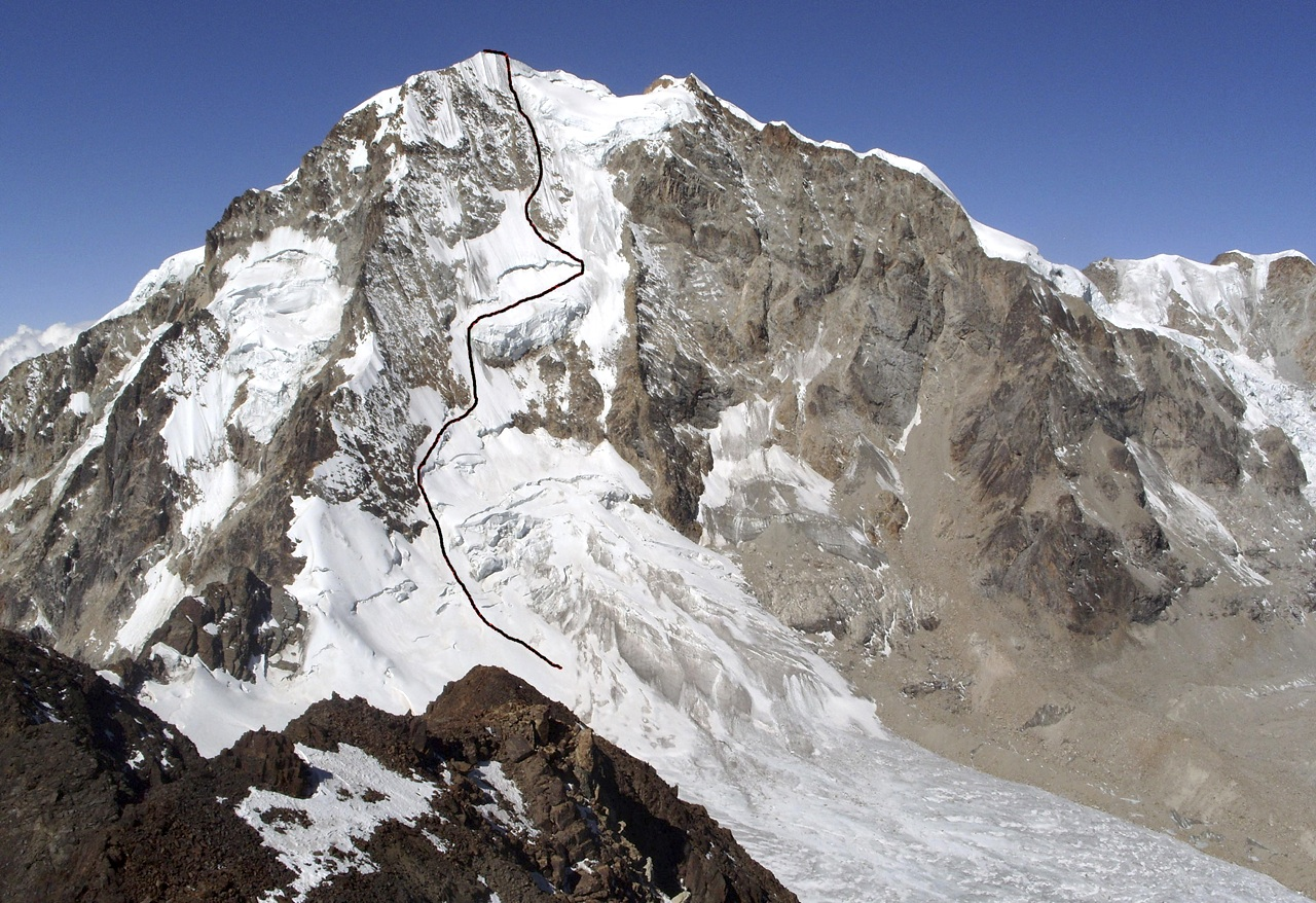 West face of Huayna Potosi from Maria Lloco. Photo taken in 2009. There was a little more snow cover in 2011, but face bears no resemblance to more snowy 1970s, when up to half a dozen lines were climbed. Marked is line followed by Beisly and Monasterio in 2011, which apart from initial section corresponds with 1970 American Direct. In 1971 an ice route was climbed up middle of rock wall on right (Via del Triangulo, 1971, D- 70°).