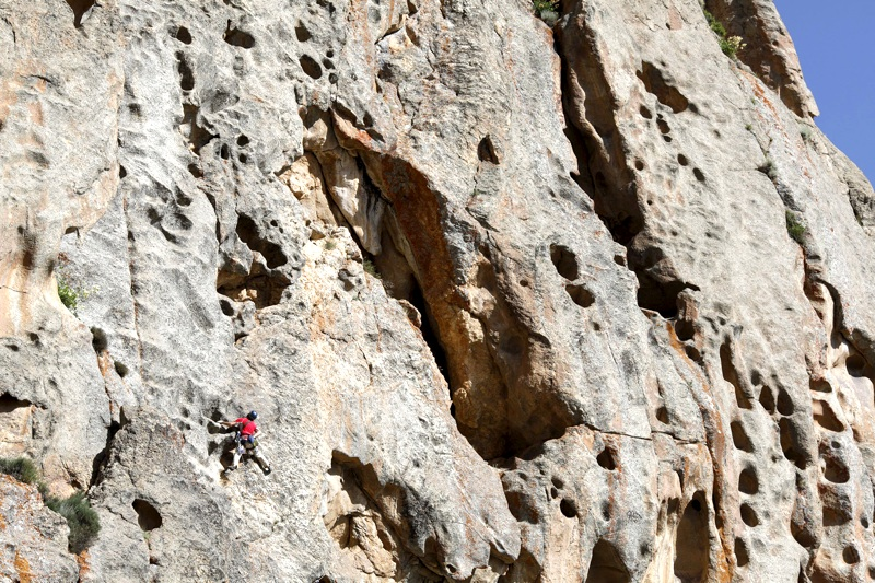 Chris Weidner amid magnificent rock architecture on third pitch during second attempt on east face of the Tooth.