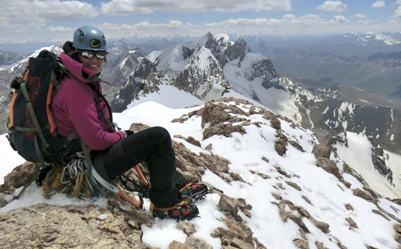 Saskia Groen on summit of Pik Oibala. First steep rock and ice pyramid on ridge behind is Brokkel. Next two are unclimbed. Last, with broad curving snow crest, is BasBas.