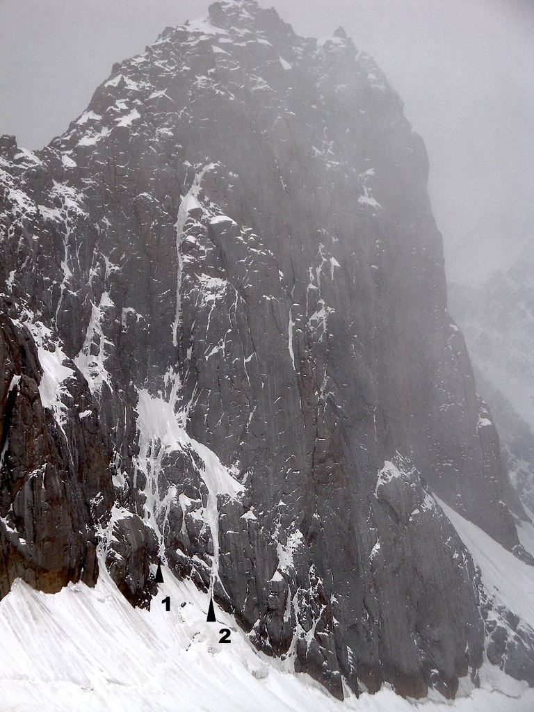 North face of misty Pik Vernyi. Cztery Pory Roku follows obvious ice streaks, then left to north ridge. (1) Start used on 2009 attempt. (2) Direct start followed in 2011.