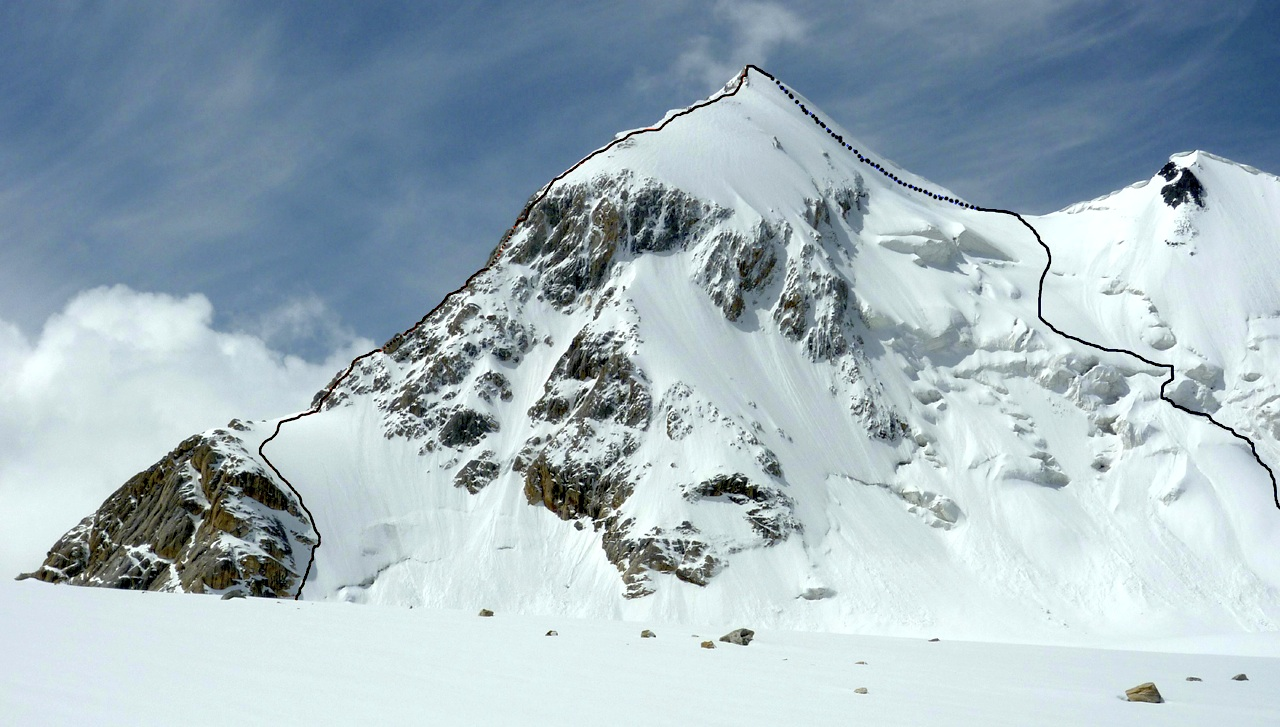 Rakhmat, with ascent route up northeast ridge (left) and descent on west face and northwest flank.
