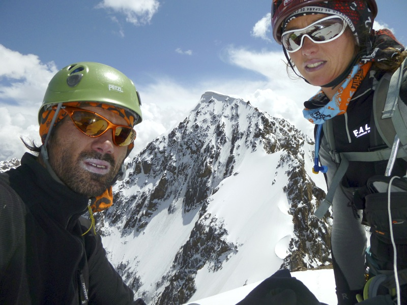 Tomeu Rubi (left) and Cati Llado on south summit of Pik 4,887m. Behind is north face of Tushunbodum. After climb of this face, pair descended northwest ridge, which faces camera.